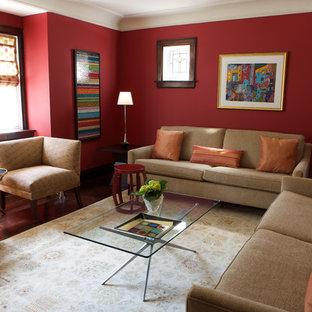 トロントの中サイズのコンテンポラリースタイルのおしゃれな独立型リビング (赤い壁、標準型暖炉、テレビなし) の写真
