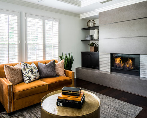 inspiration for a transitional dark wood floor and brown floor living room remodel in orange county - Transitional Design Ideas