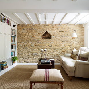 Photo of a small farmhouse living room in Oxfordshire with white walls, a wood burning stove and a built-in media unit.