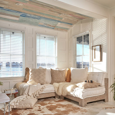 Example of a small cottage chic open concept painted wood floor and white floor living room design in Providence with white walls