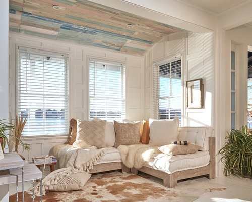 Example Of A Small Cottage Chic Open Concept Painted Wood Floor And White Living Room