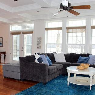Ejemplo de salón para visitas abierto, de estilo de casa de campo, extra grande, sin televisor, con paredes blancas, suelo de madera en tonos medios, chimenea tradicional, marco de chimenea de piedra y suelo naranja