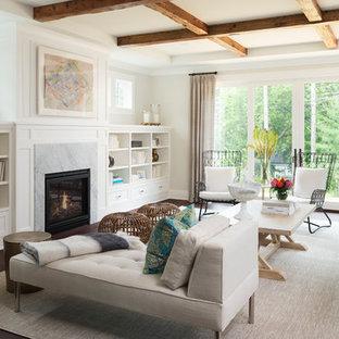 ミネアポリスの大きいビーチスタイルのおしゃれなリビング (白い壁、濃色無垢フローリング、標準型暖炉、テレビなし、茶色い床、木材の暖炉まわり) の写真