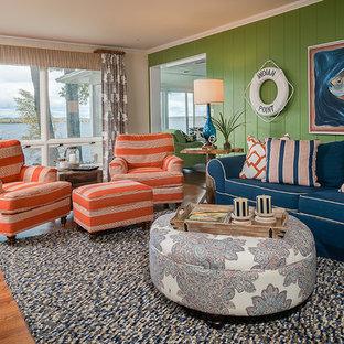 他の地域の中サイズのビーチスタイルのおしゃれなLDK (緑の壁、クッションフロア、標準型暖炉、石材の暖炉まわり) の写真
