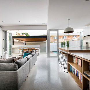 Inspiration for a contemporary formal and open concept living room remodel in Perth with white walls and a wall-mounted tv