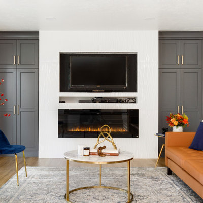 Example of a mid-sized trendy open concept laminate floor and beige floor living room design in Salt Lake City with white walls, a standard fireplace, a tile fireplace and a wall-mounted tv