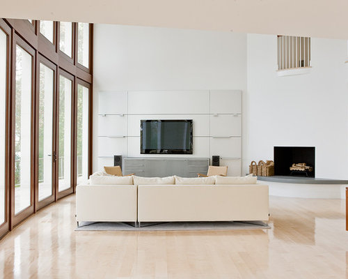 Trendy Open Concept Living Room Photo In Boston With A Corner Fireplace And Wall