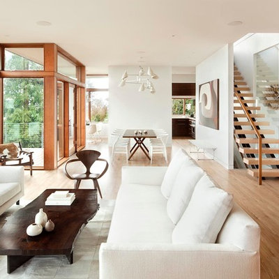 Inspiration for a modern open concept light wood floor living room remodel in Portland with white walls