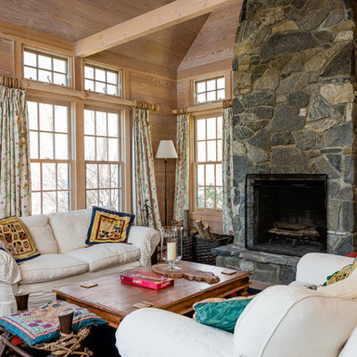Example of a mid-sized cottage open concept living room design in Boston with a stone fireplace, a standard fireplace and no tv
