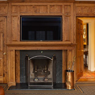 Inspiration for a traditional formal living room in Cincinnati with beige walls, carpet, a standard fireplace, a stone fireplace surround and a built-in media wall.