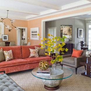 Cette image montre un grand salon design fermé avec un mur orange et un sol beige.