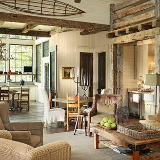 Esempio di un soggiorno rustico aperto con pareti beige e angolo bar