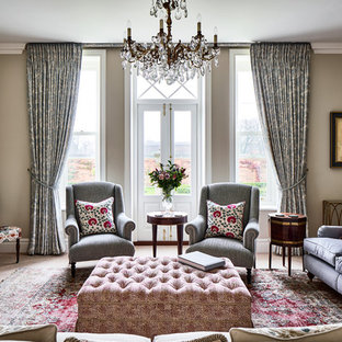 This is an example of a classic formal living room in Cheshire with grey walls and a standard fireplace.