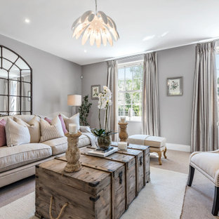 This is an example of a living room in Hampshire with grey walls, carpet and grey floors.
