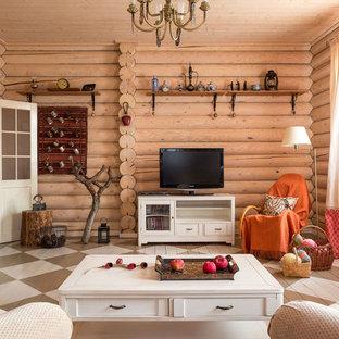 Ispirazione per un soggiorno stile rurale con sala formale, pavimento in legno verniciato, TV autoportante e pareti marroni