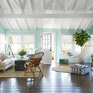 Small coastal open concept medium tone wood floor and brown floor living room photo in New York with green walls