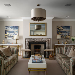Design ideas for a medium sized traditional living room in London with beige walls, carpet, a standard fireplace and grey floors.