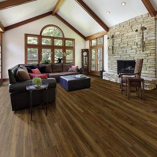Foto de salón abierto, clásico, grande, sin chimenea, con paredes blancas, suelo vinílico y suelo marrón