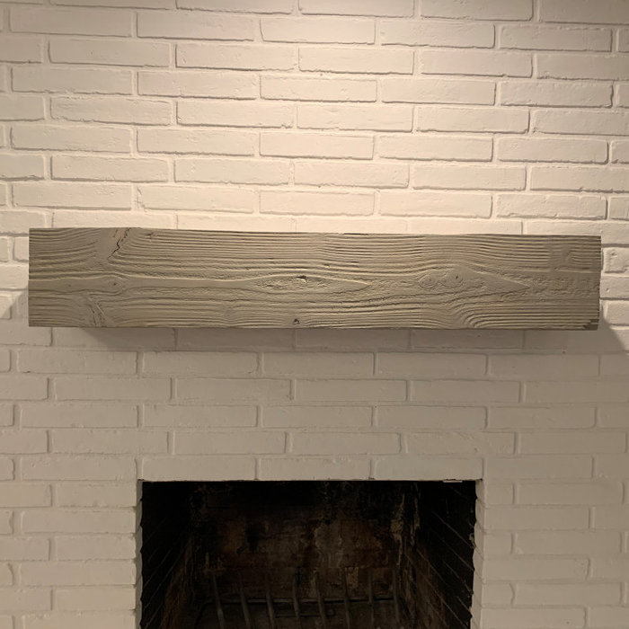 Example of a country living room design in Austin with a brick fireplace