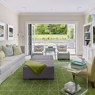 This is an example of a large transitional living room in San Francisco with beige walls and a built-in media wall.