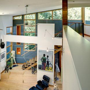 Idéer för funkis allrum med öppen planlösning, med vita väggar