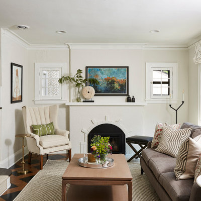 Example of a mid-sized transitional enclosed medium tone wood floor living room design in Minneapolis with beige walls