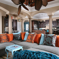 tropical living room by Savvy Surrounding Style