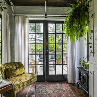 Inspiration for a country enclosed living room in Portland with white walls, dark hardwood floors, no tv and brown floor.
