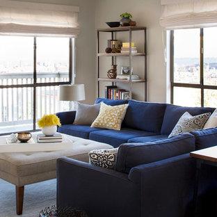 Exemple d'un salon tendance de taille moyenne et fermé avec un mur gris.