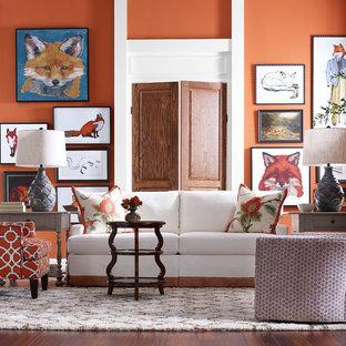 Esempio di un soggiorno tradizionale di medie dimensioni e chiuso con sala formale, pareti arancioni, parquet scuro, nessun camino e nessuna TV