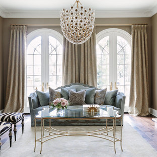 Foto de salón para visitas cerrado, tradicional, grande, sin televisor, con paredes marrones, suelo de madera oscura y chimenea tradicional