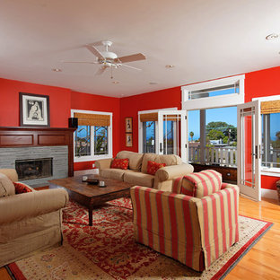 Example of an arts and crafts living room design in San Diego with red walls and a standard fireplace