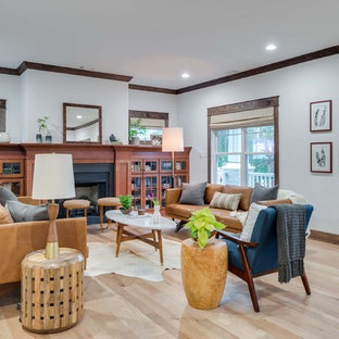 Example of an arts and crafts open concept light wood floor living room design in Atlanta with white walls