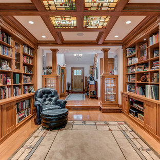 Example of a large arts and crafts open concept light wood floor living room library design in Chicago with beige walls, no fireplace and no tv