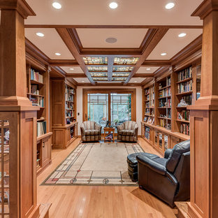 Large arts and crafts open concept light wood floor living room library photo in Chicago with beige walls and no tv