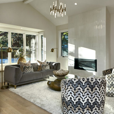 Living room - large contemporary formal and open concept medium tone wood floor and beige floor living room idea in San Francisco with beige walls, a ribbon fireplace, a tile fireplace and a wall-mounted tv
