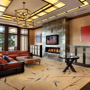 サンディエゴの大きいアジアンスタイルのおしゃれなLDK (フォーマル、壁掛け型テレビ、ベージュの壁、濃色無垢フローリング、横長型暖炉、タイルの暖炉まわり、茶色い床) の写真