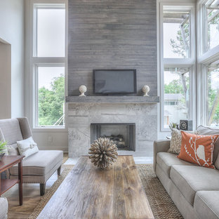Large transitional open concept medium tone wood floor living room photo in Nashville with white walls, a standard fireplace, a tile fireplace and a tv stand