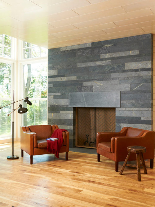 Fireplace Tile Design Ideas a common way to use tile on a fireplace is to install it on the fireplace surround where the tile is applied to the area directly surrounding the fireplace Modern Living Room Idea In Minneapolis With Medium Tone Hardwood Floors And A Stone Fireplace Surround
