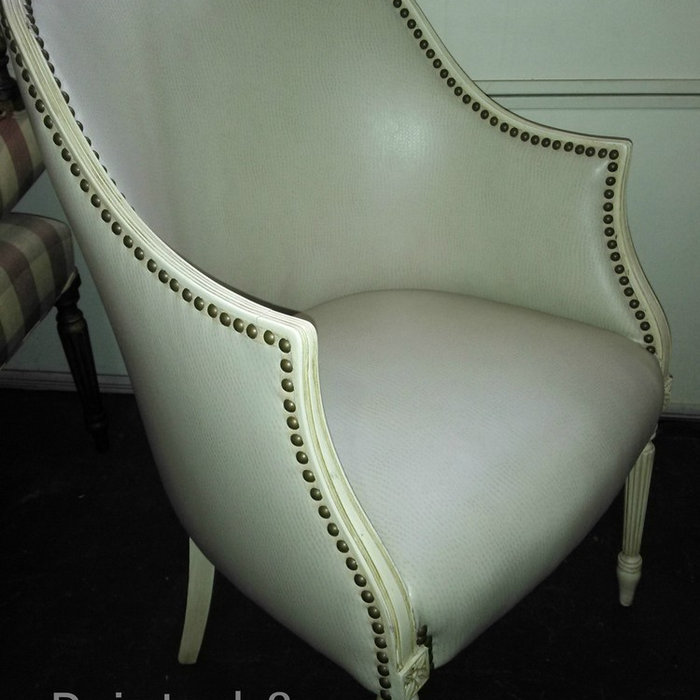 Cream faux leather chair with nail heads