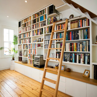 Example of a transitional living room library design in London