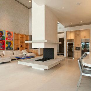 チャールストンのコンテンポラリースタイルのおしゃれなLDK (ベージュの壁、両方向型暖炉) の写真