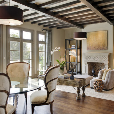 Inspiration for a mediterranean living room remodel in Dallas with beige walls and a standard fireplace
