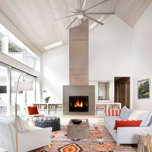 Example of a mid-sized farmhouse open concept light wood floor living room design in Other with white walls, a standard fireplace, no tv and a tile fireplace