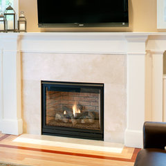 modern living room Crema Marfil Marble Fireplace
