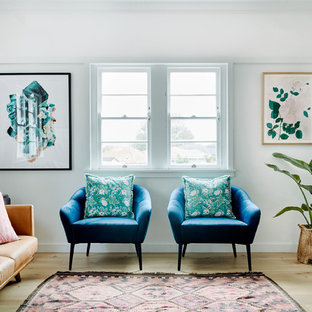 Inspiration for a midcentury formal enclosed living room in Sydney with white walls and light hardwood floors.