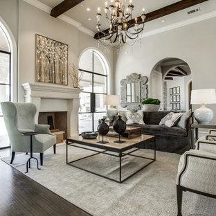 Inspiration för stora klassiska allrum med öppen planlösning, med beige väggar, mörkt trägolv, en standard öppen spis, brunt golv, ett finrum och en spiselkrans i sten