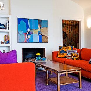 Cette image montre un salon bohème de taille moyenne et ouvert avec une salle de réception, un mur blanc, moquette, une cheminée standard, un manteau de cheminée en bois, aucun téléviseur et un sol violet.