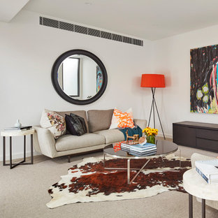 Inspiration for a contemporary living room in Melbourne with white walls, carpet, no tv and beige floor.