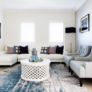 Inspiration for a transitional living room in Sydney with white walls, ceramic floors, no fireplace and beige floor.